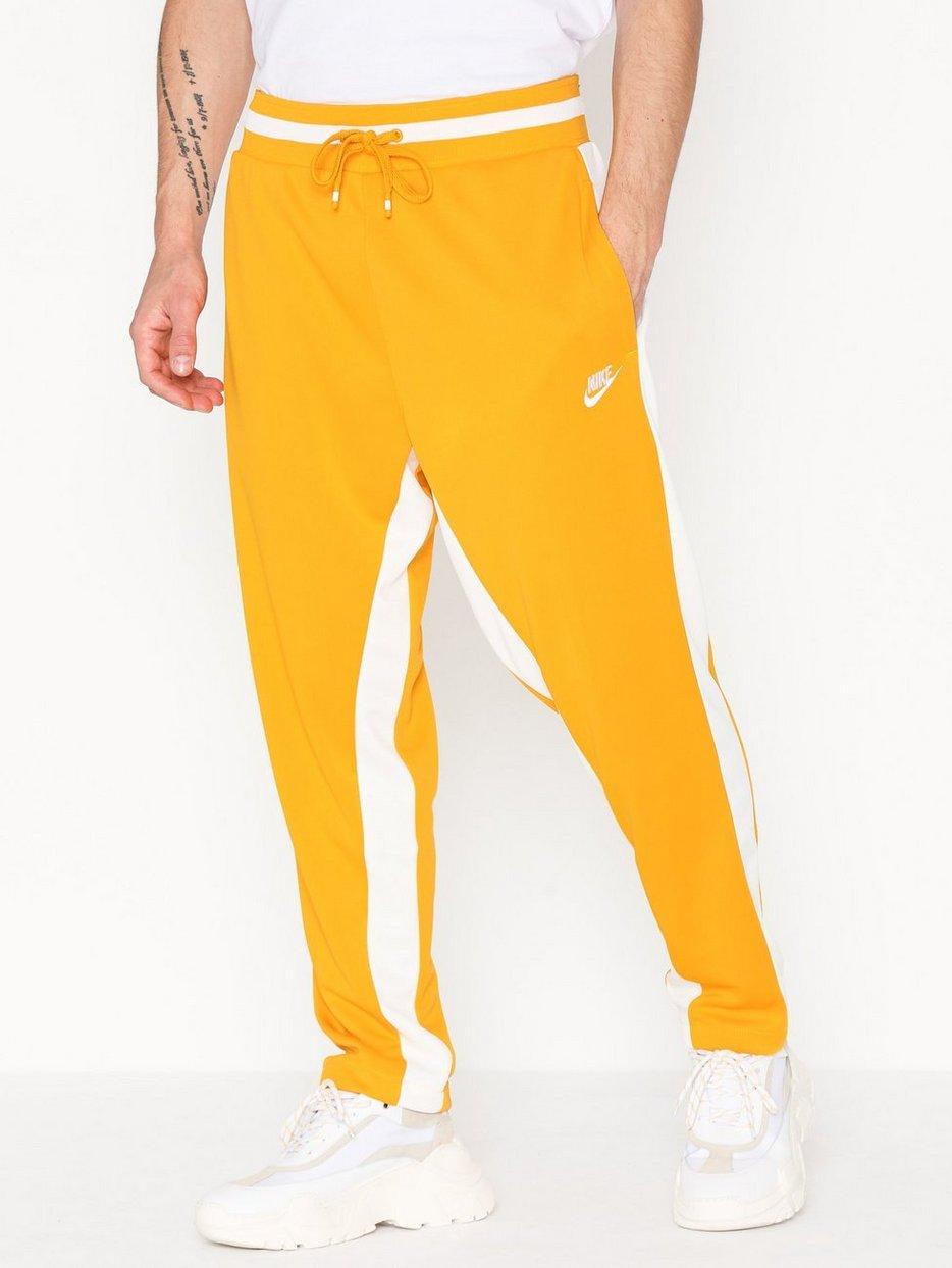 f9d5137f35 M Nsw Nike Air Pant Pk - Nike Sportswear - Yellow - Pants - Clothing ...