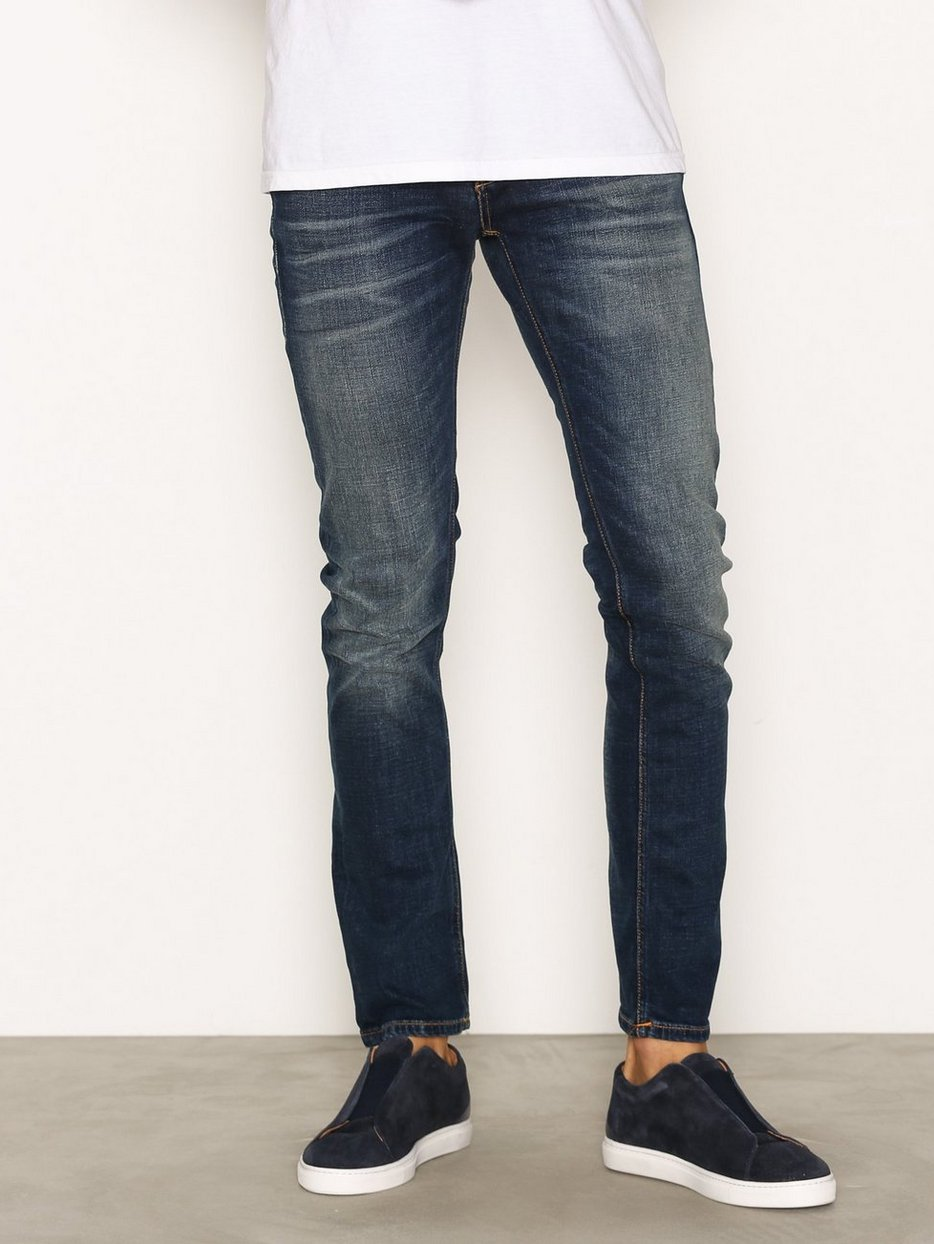 grim tim revelation blue nudie jeans indigo jeans. Black Bedroom Furniture Sets. Home Design Ideas